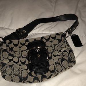 Coach mini bag black with large buckle